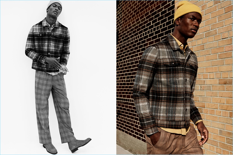Hamid Onifade embraces fall's plaid trend. Connecting with Zara Man, he wears a plaid jacket and check trousers. The model adds a pop of color with a yellow shirt and knit beanie.