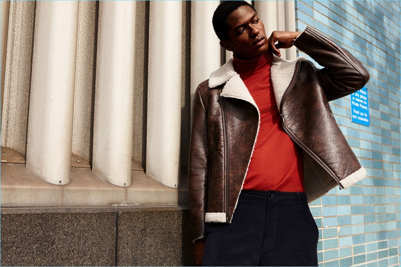 Ready for the new season, Hamid Onifade rocks a Zara faux leather jacket. A red turtleneck and corduroy trousers complete his look.