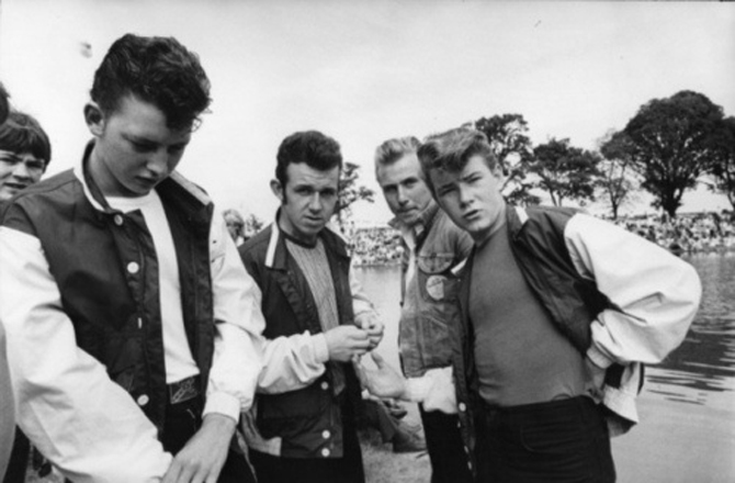 1950s youth wear trendy pompadours and bomber jackets.