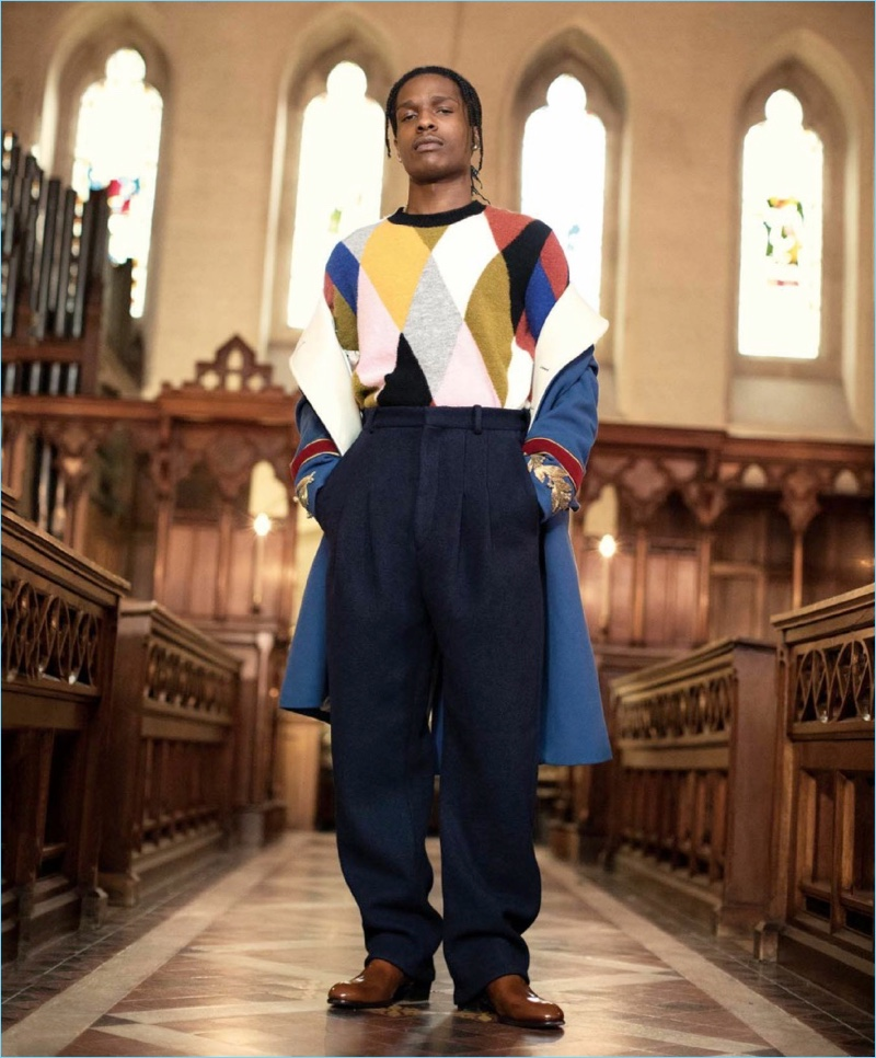 Making a colorful statement, A$AP Rocky wears a Kenzo sweater with a Gucci coat. The rapper also sports Acne Studios pants and Jimmy Choo boots.
