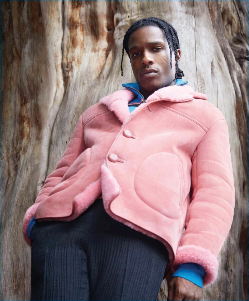 Rocking a pink Burberry jacket, A$AP Rocky also wears a J.W. Anderson sweater and Jil Sander pants.