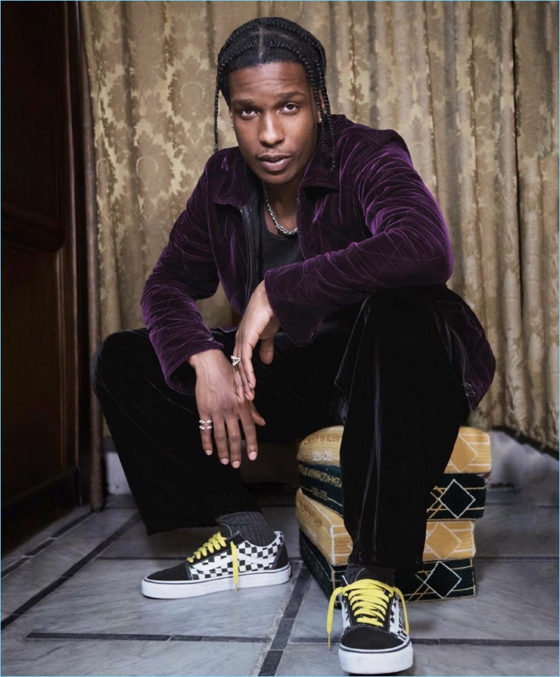 Connecting with GQ Style, A$AP Rocky wears a purple velvet jacket and tank by Berluti. Emporio Armani velvet trousers and Vans sneakers complete the look.