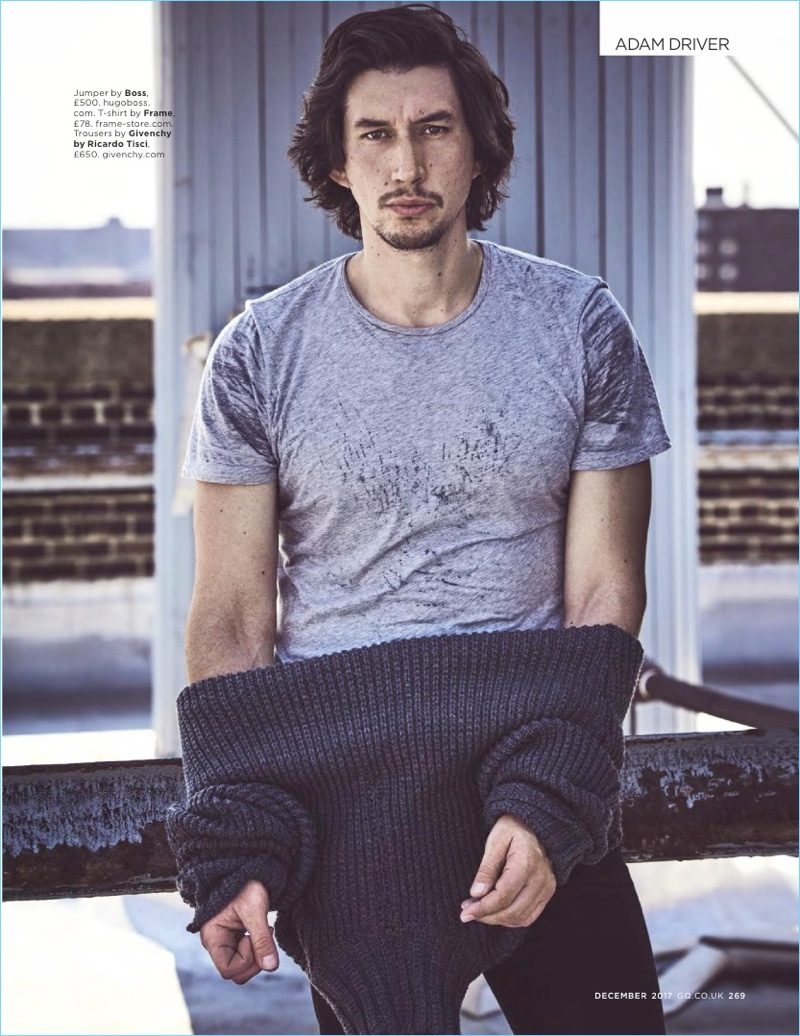 Star Wars actor Adam Driver sports a BOSS sweater with a Frame t-shirt and Givenchy pants.