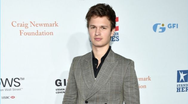 Ansel Elgort wears a double-breasted suit by Stella McCartney.