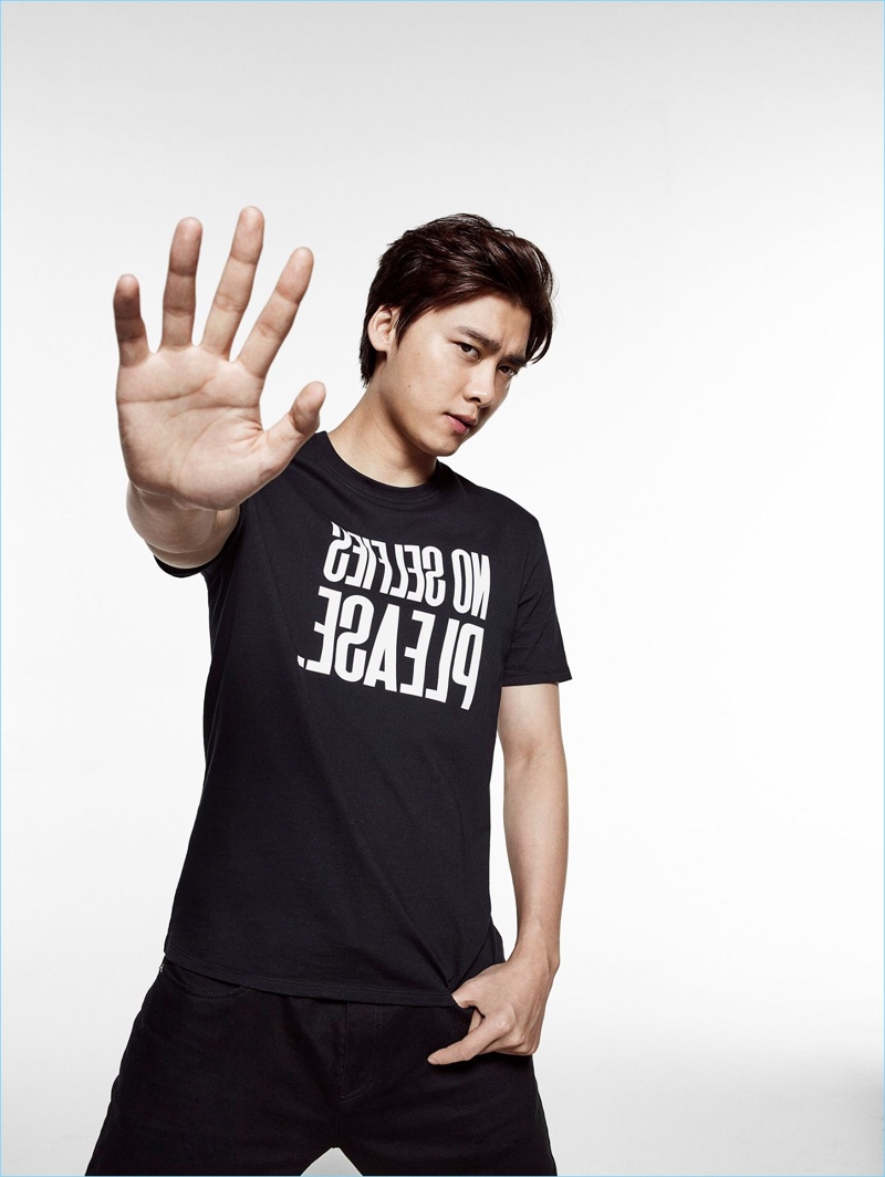 """Actor Li Yifeng wears a """"No Selfies Please"""" t-shirt for Armani Exchange's statement campaign."""