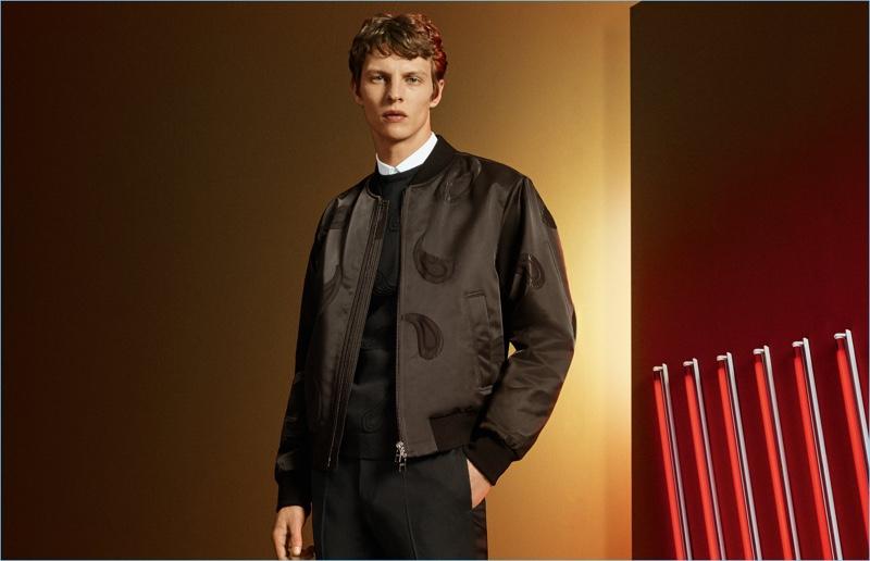 German model Tim Schuhmacher wears a bomber jacket from BOSS by Hugo Boss.