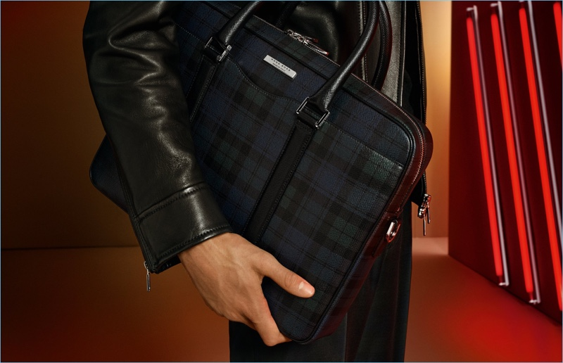 BOSS highlights a plaid bag as part of its holiday 2017 gift guide.