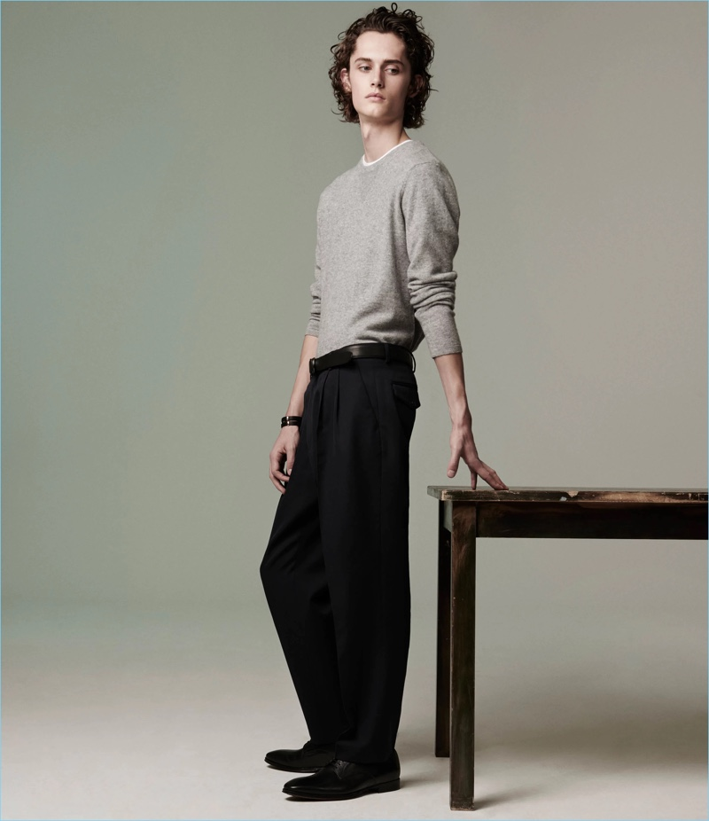 A grey Barneys New York sweater and leather bluchers complement Dries Van Noten wool trousers.