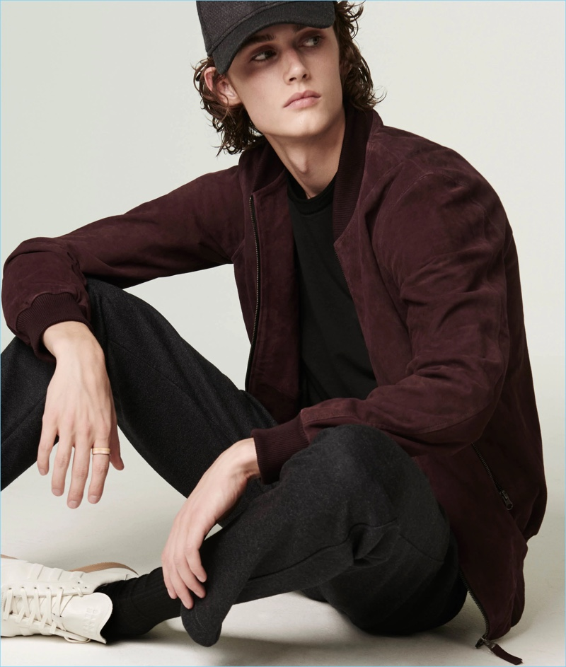 Several smart collaborations contribute to Barneys' lineup. The retailer parters with Lot 78 for a suede bomber jacket. It looks great with Barneys' New Era baseball cap. Complete the look with Barneys trousers and the retailer's Adidas sneakers.