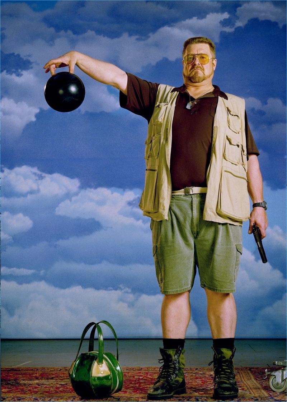John Goodman wears Ray-Ban Ambermatic aviator sunglasses as Walter Sobchak in the 1998 classic, The Big Lebowski.