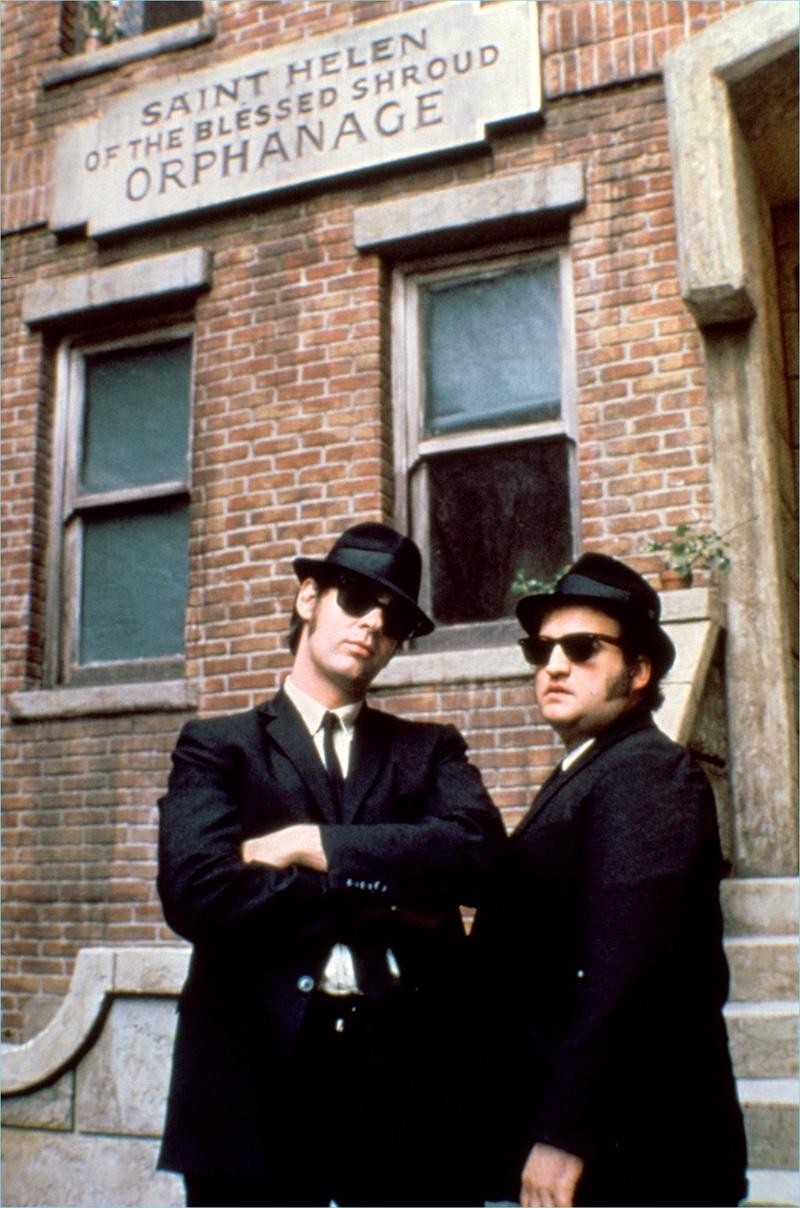 Dan Aykroyd and John Belushi don Ray-Ban wayfarer sunglasses for 1980's The Blues Brothers.