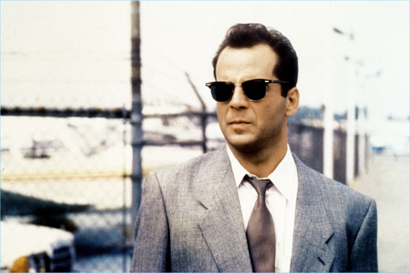 Sporting Ray-Ban aviator sunglasses, Bruce Willis plays David Addison Jr. in the television series, Moonlighting.