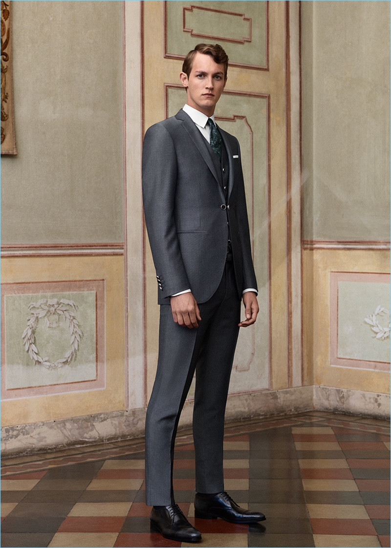 A striking vision, Rutger Schoone dons a grey suit by Canali.