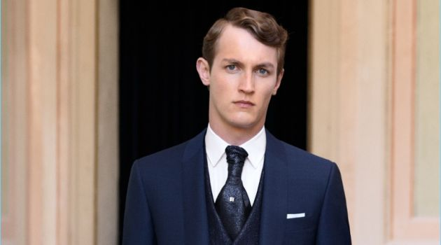 Model Rutger Schoone wears a sharp navy suit from Canali.