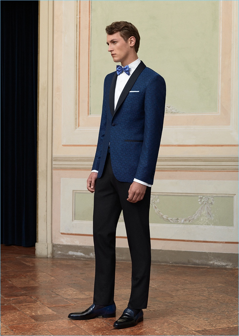 Dressed to the nines, Rutger Schoone wears a navy evening jacket and trousers by Canali.