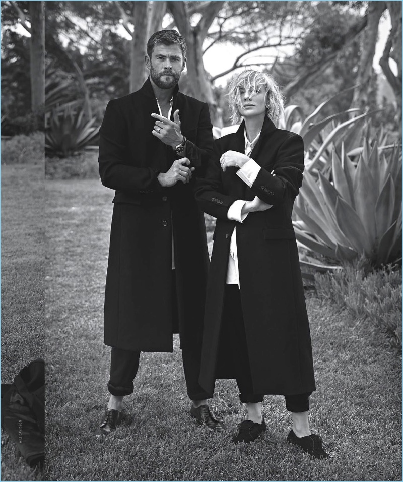 Embracing tailoring, Chris Hemsworth and Cate Blanchett pose for a picture. Hemsworth dons a Wardrobe NYC coat, Louis Vuitton shirt, and Giorgio Armani trousers.
