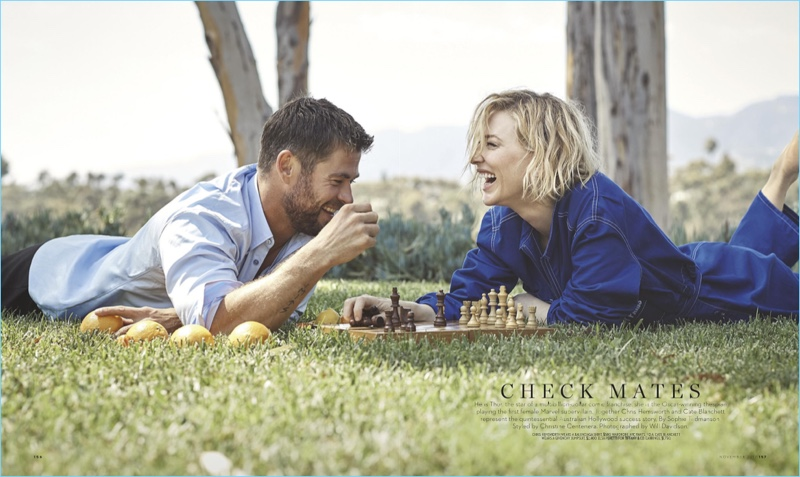 Laughing, Chris Hemsworth and Cate Blanchett play a game of chess. Hemsworth sports a Balenciaga shirt and Wardrobe NYC pants.