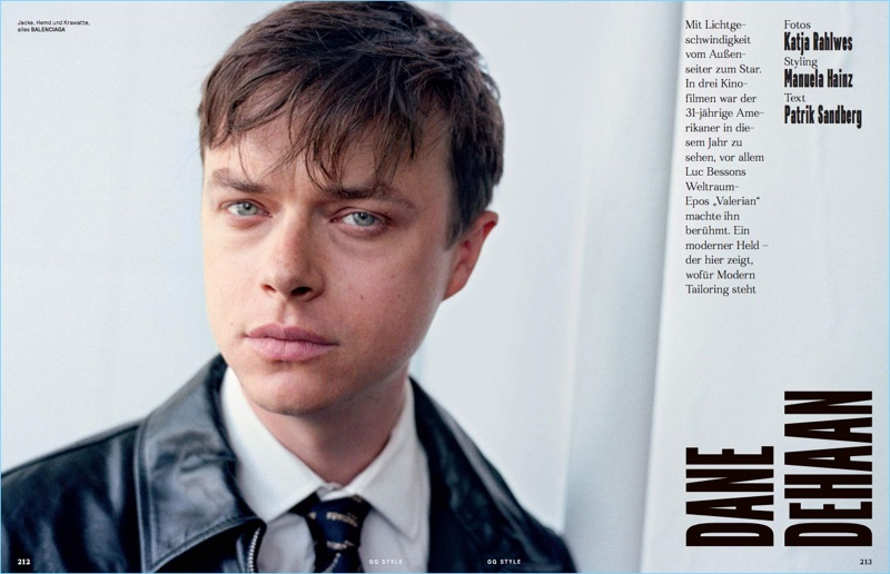 Dane DeHaan wears a leather trench and other fashions by Balenciaga.