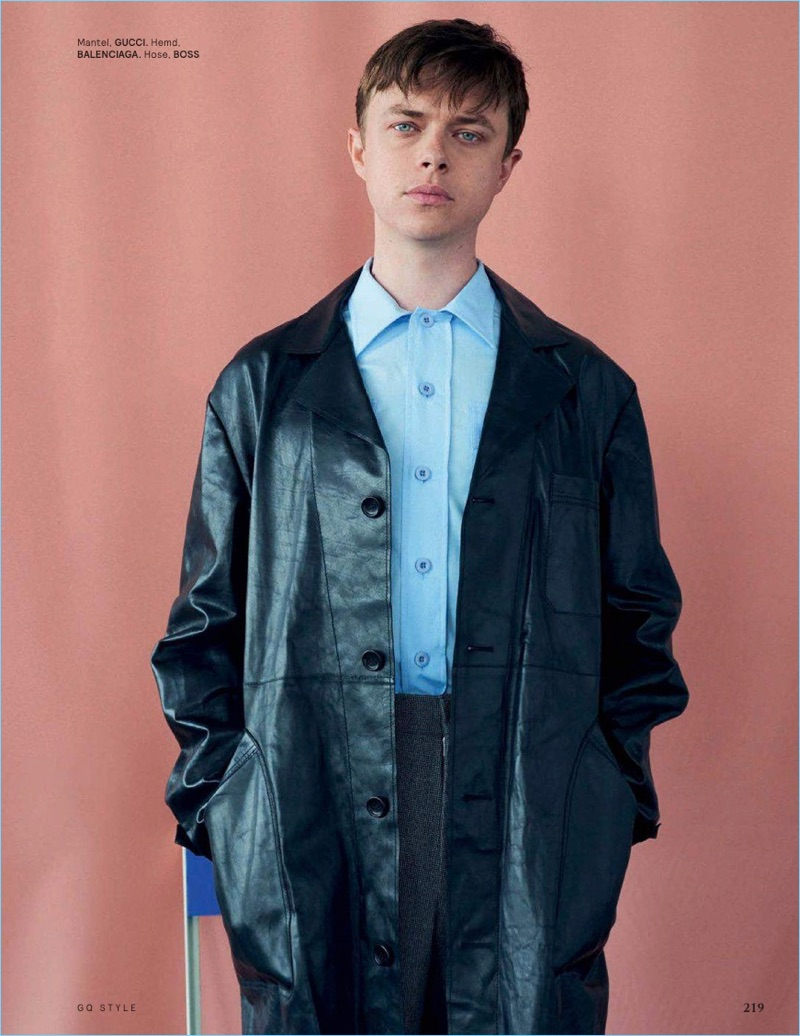 Sporting a leather Gucci coat, Dane DeHaan also wears a Balenciaga shirt and BOSS pants.