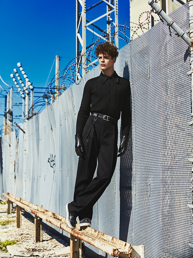Sidney wears top Prada, belt, pants, shoes, and gloves Dior Homme.