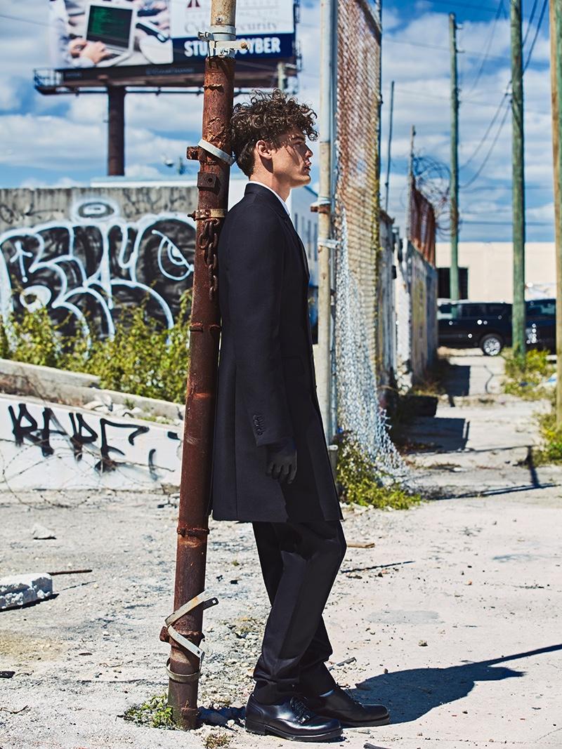 Sidney wears coat, pants, and shoes Bottega Veneta.