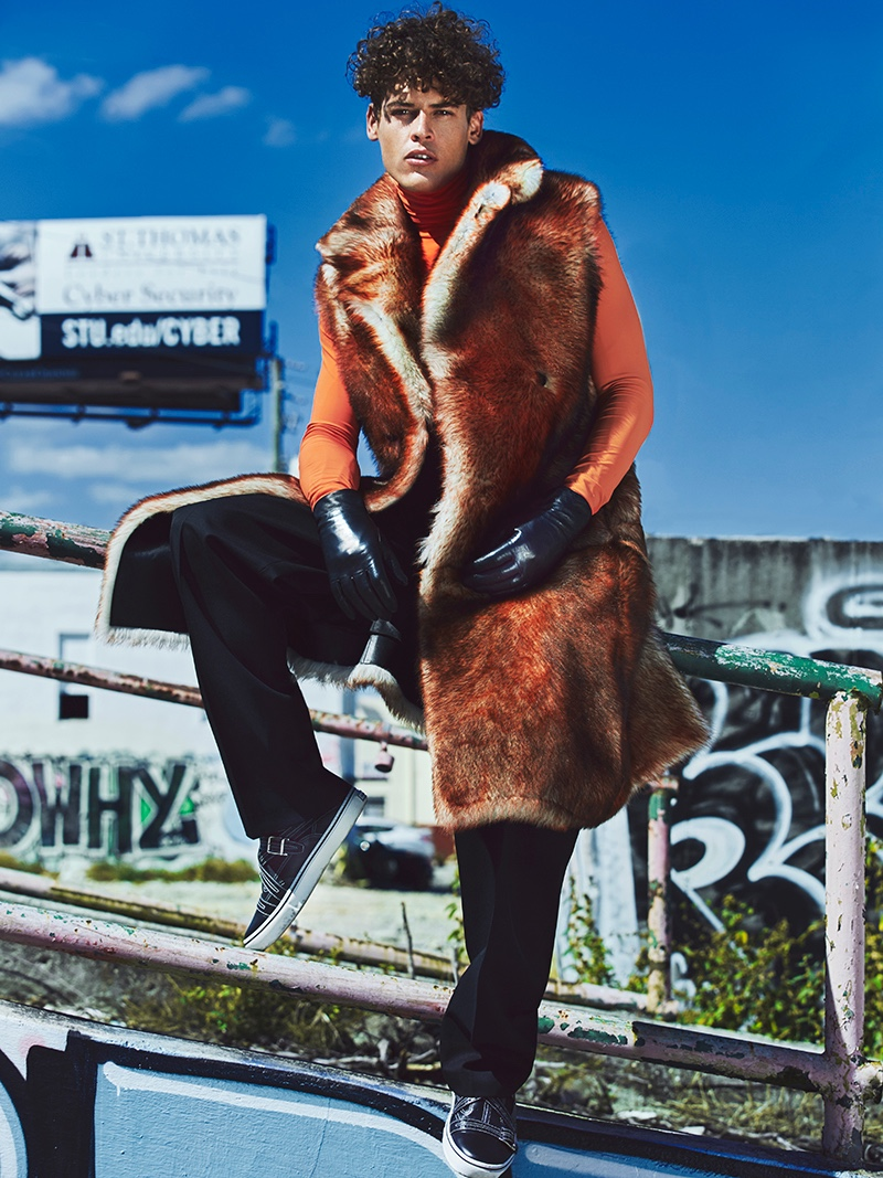 Sidney wears sweater, fur vest, gloves, pants, and shoes Dior Homme.