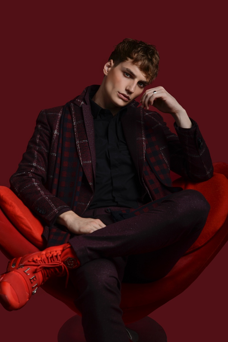 Felix Velbinger wears suit Daks, check scarf Canali, shirt Les Hommes, and red shoes Philipp Plein.