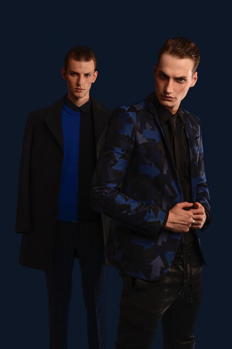 Left to Right: Thomas Barry wears shirt Daks, sweater and coat Dirk Bikkembergs. Felix Velbinger wears pants Philipp Plein, shirt, tie, and jacket Les Hommes.
