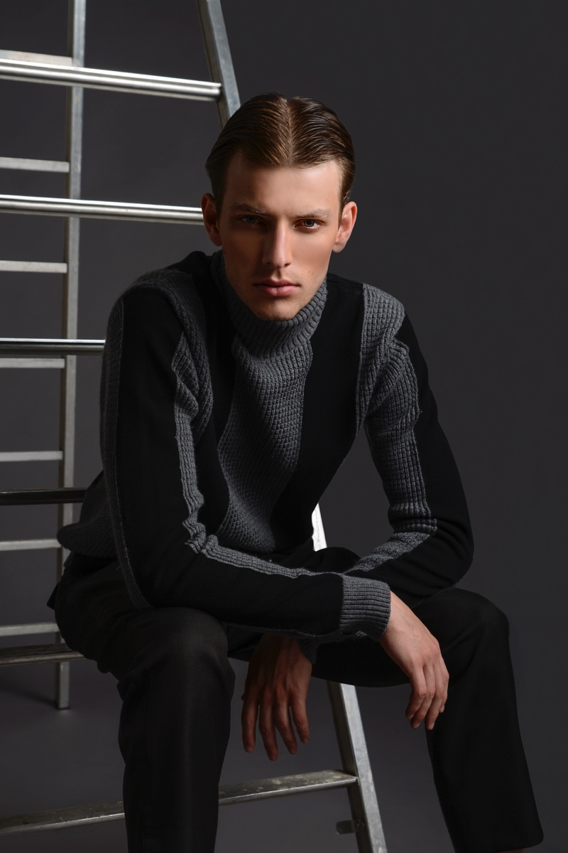 Thomas Barry wears sweater and pants Dirk Bikkembergs.