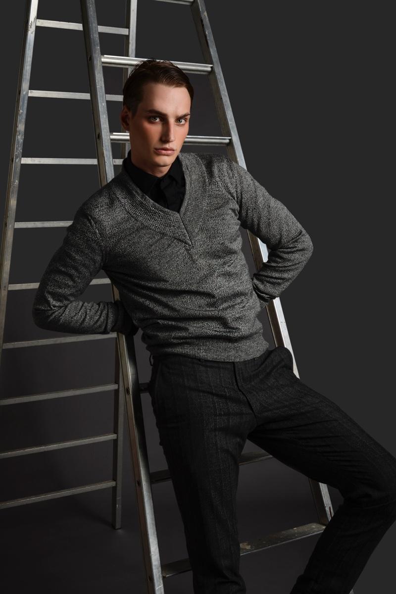 Felix Velbinger wears shirt Les Hommes, v-neck sweater Dirk Bikkembergs, and pants Daks.