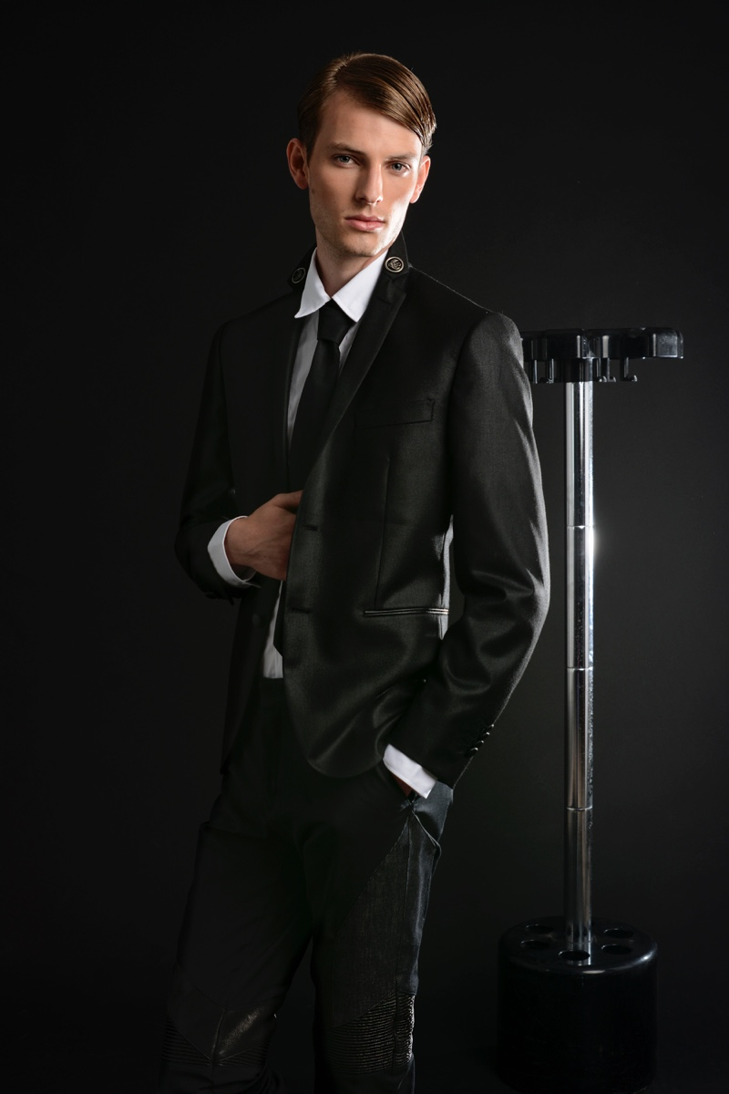 Thomas Barry wears tie Daks, shirt and suit Frankie Morello.