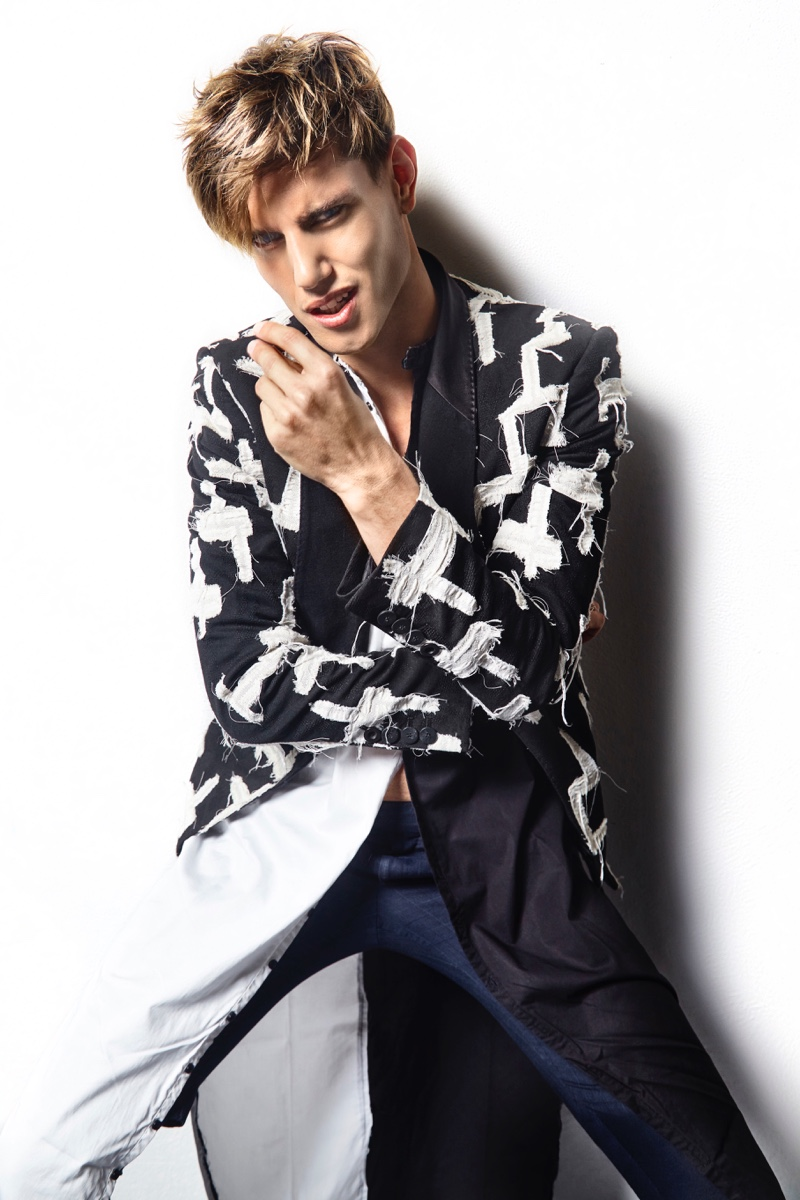 Marco Castelli wears jacket Tom Rebl, shirt, shorts, and pants his own.
