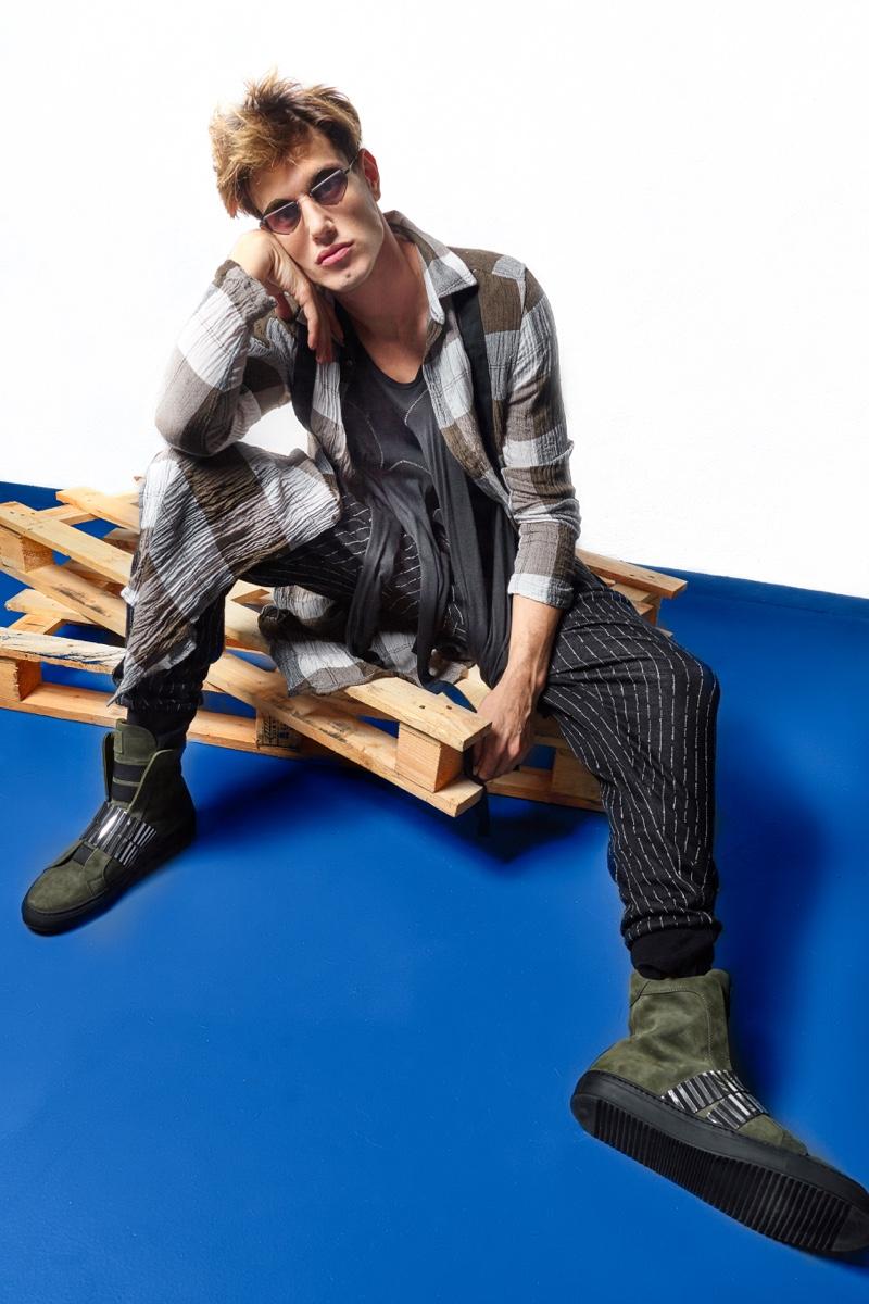 Marco Castelli wears boots JF London, sunglasses  Eyepetizer, shirt, t-shirt and pants Tom Rebl.