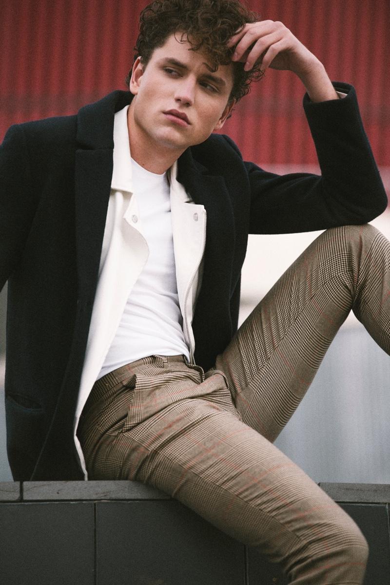 Model Steve Sarkozy sports a smart look by Zara Man.