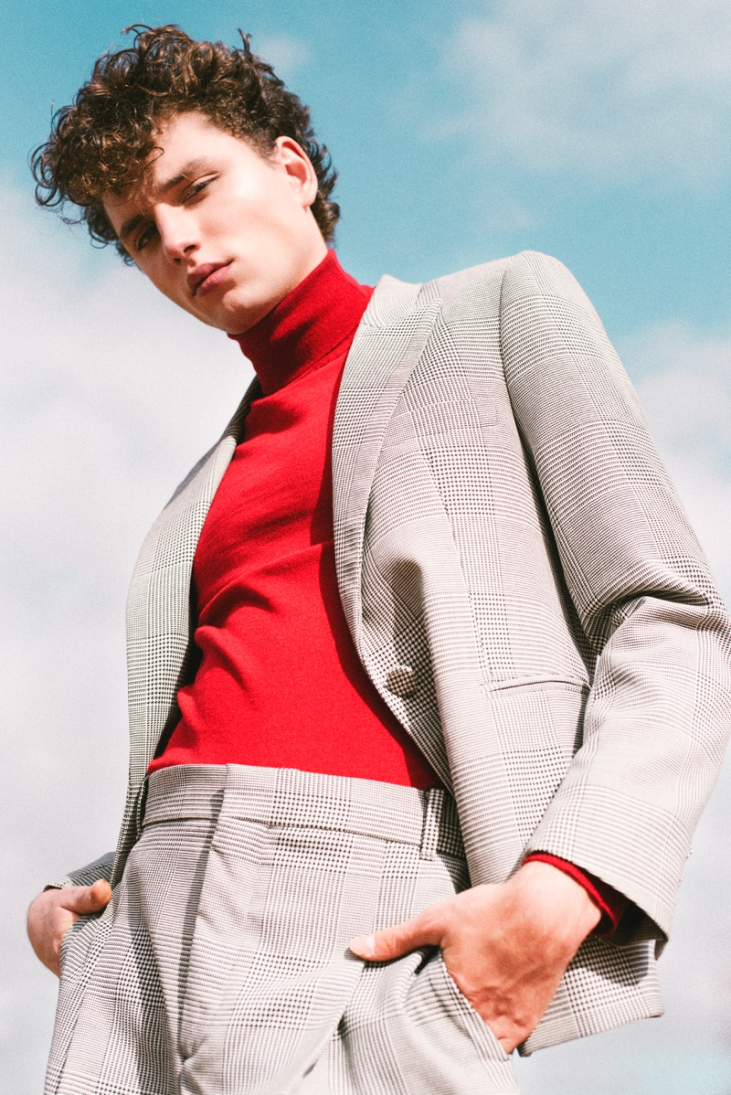 Making a chic statement, Steve Sarkozy wears a red turtleneck with a sharp suit.