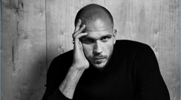 Connecting with The Laterals, Gustaf Skarsgård sports a Theory turtleneck. He also wears Hugo Boss trousers and a Bell & Ross watch.