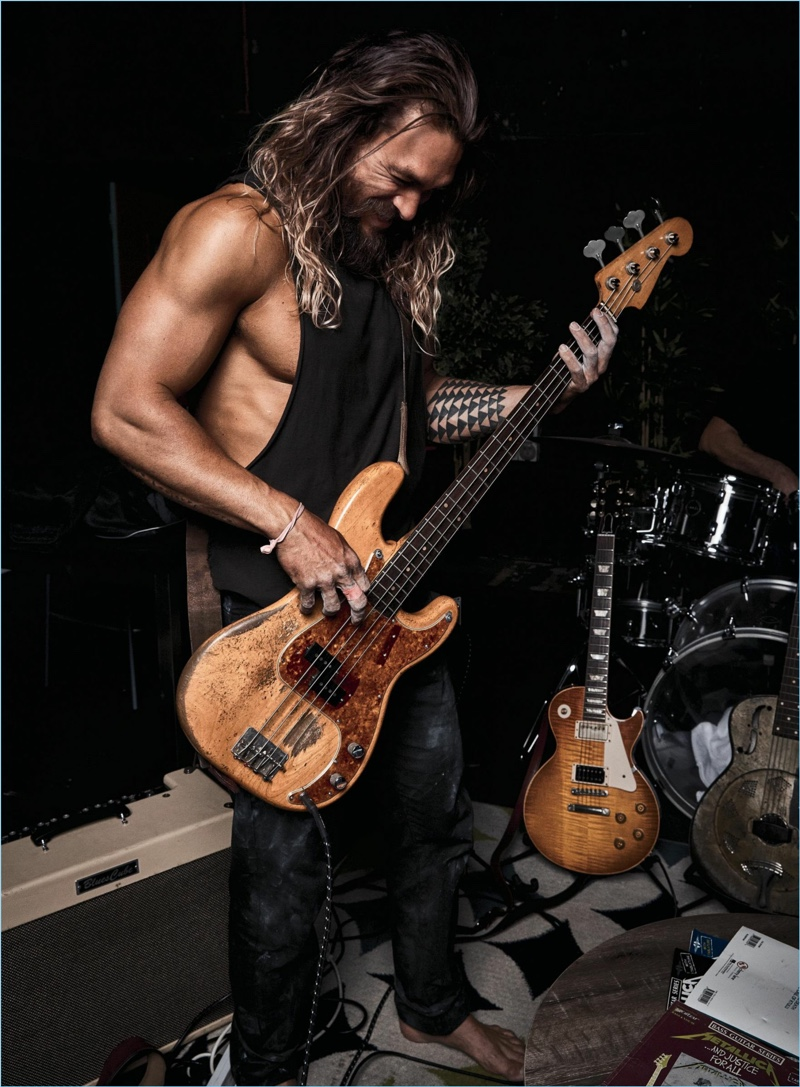 Playing the guitar, Jason Momoa stars in a new photo shoot.