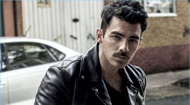 A cool vision, Joe Jonas rocks a Salvatore Ferragamo leather jacket. The singer also dons a sweater and pants by GUESS.