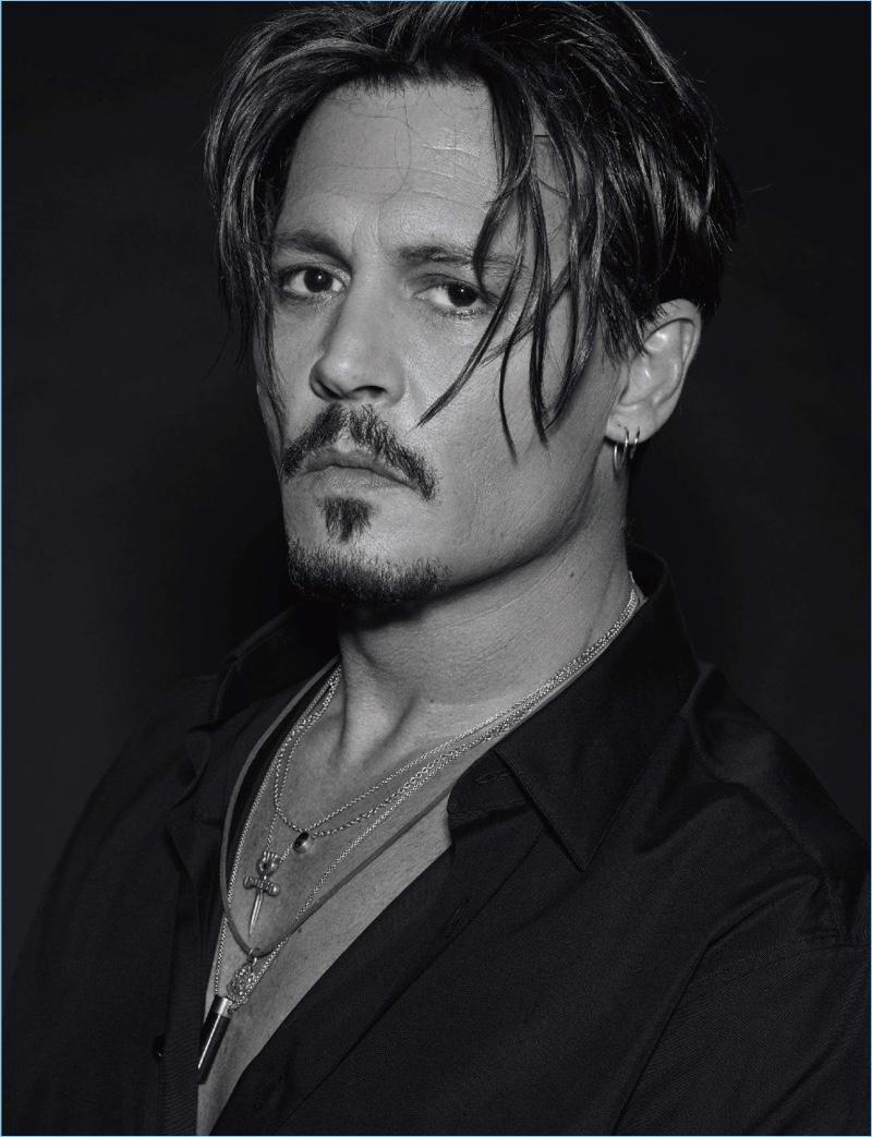 Delivering a piercing gaze, Johnny Depp poses for a portrait.