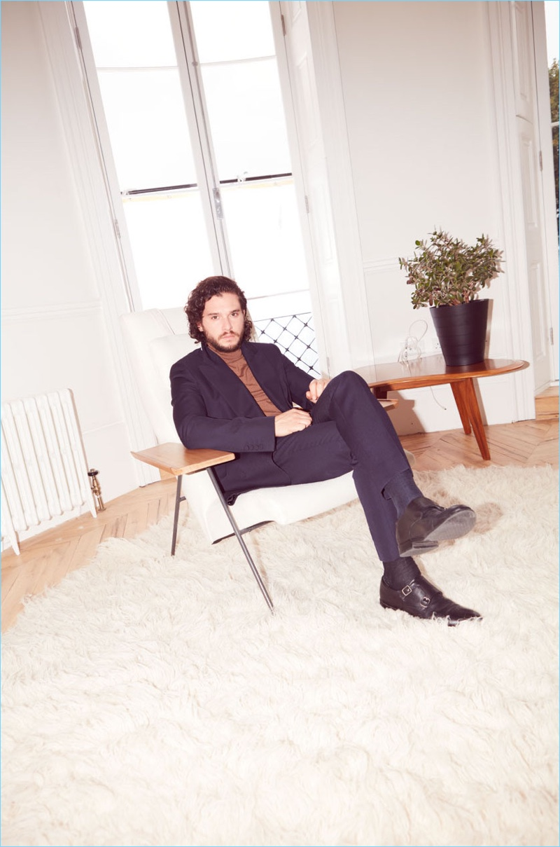 Connecting with The Guardian, Kit Harington wears a Dries Van Noten suit with an Acne Studios turtleneck and Gordon Rush shoes.