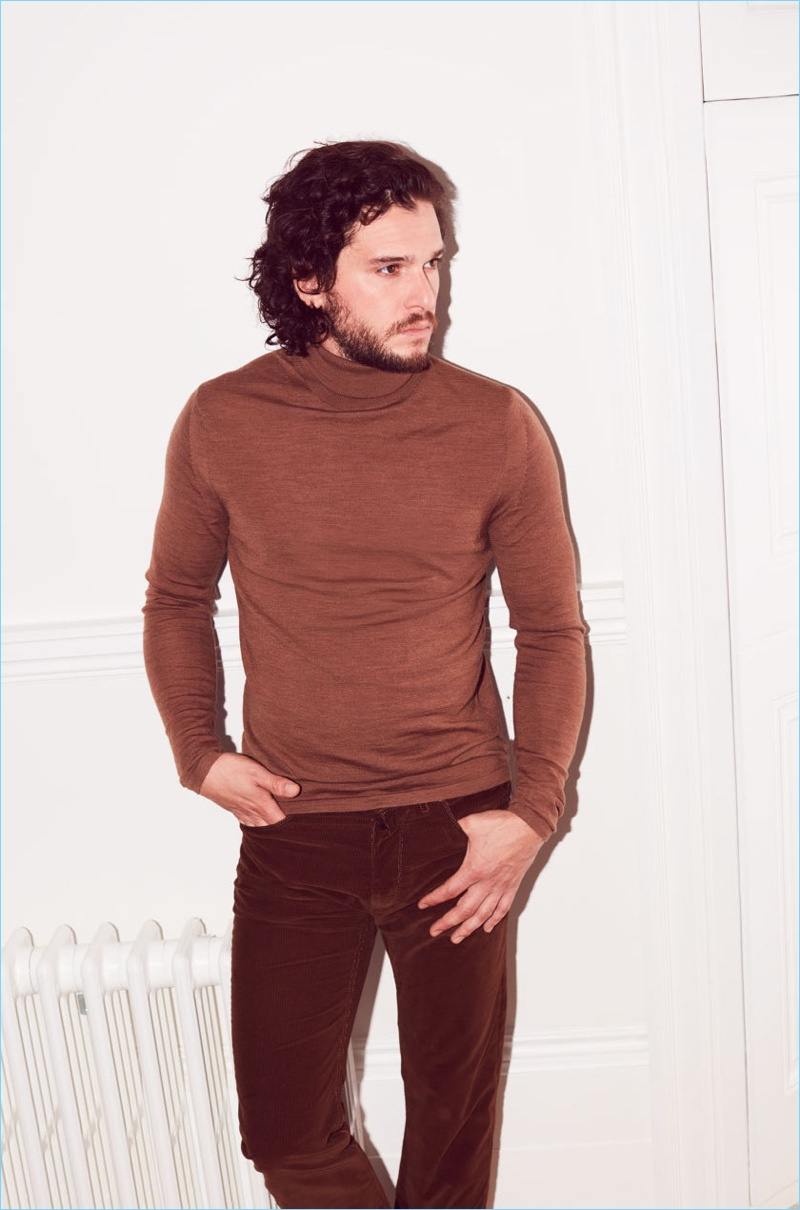 Actor Kit Harington sports a brown turtleneck by Acne Studios with Lanvin trousers.