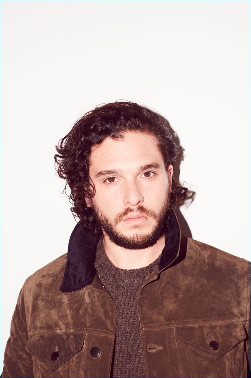 Kit Harington wears a jacket and sweater by Berluti.