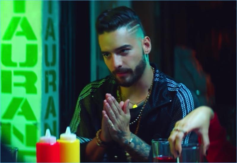 Colombian singer Maluma wears an Adidas by Alexander Wang mesh track jacket.