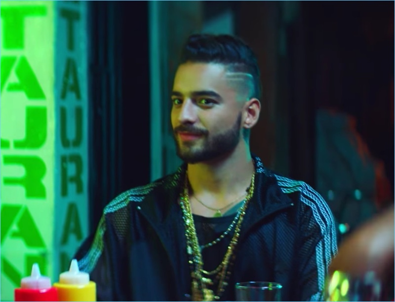 Maluma makes an appearance in the Hola music video for his song with Flo Rida.