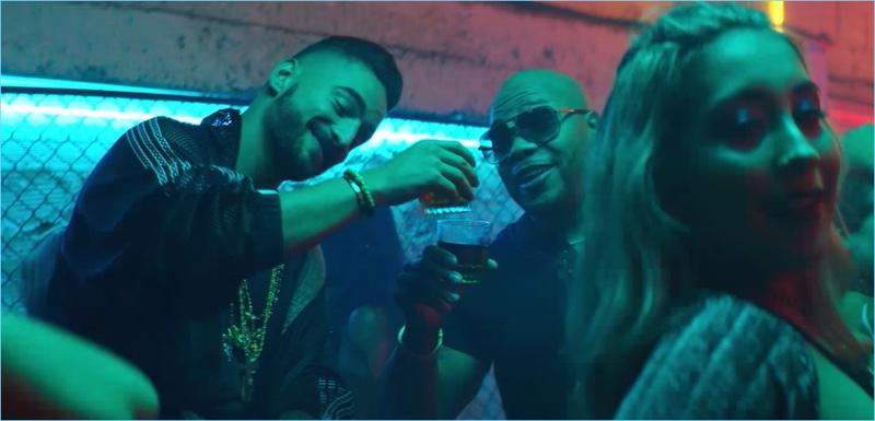Singer Maluma joins Flo Rida for their Hola music video.