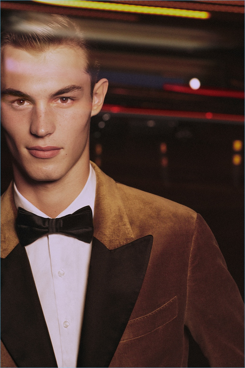 Kit Butler dons a brown tuxedo jacket for Mango's holiday 2017 campaign.