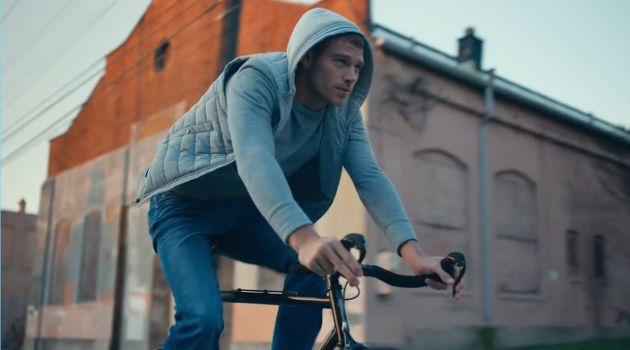 American model Matthew Noszka rides a bike in Express' Tough denim jeans.