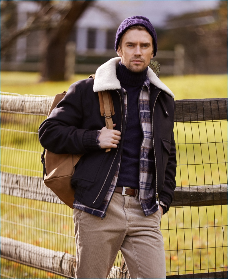 Make a chic impression with a Howlin' turtleneck sweater. It's perfection with an AMI jacket and Stüssy plaid shirt. East Dane completes the look with a HUGO belt, Filson backpack, and Norse Projects corduroy pants.