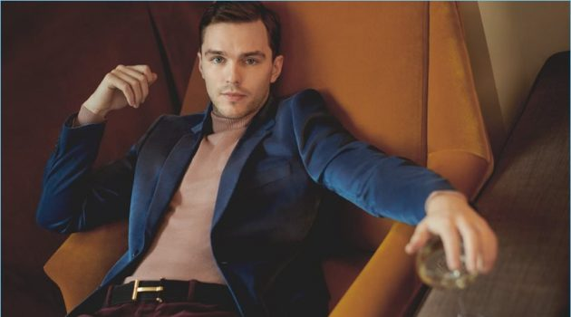 Nicholas Hoult wears a Paul Smith velvet blazer with an Oliver Spencer turtleneck sweater. He also dons Valentino corduroy trousers and a Tom Ford belt.