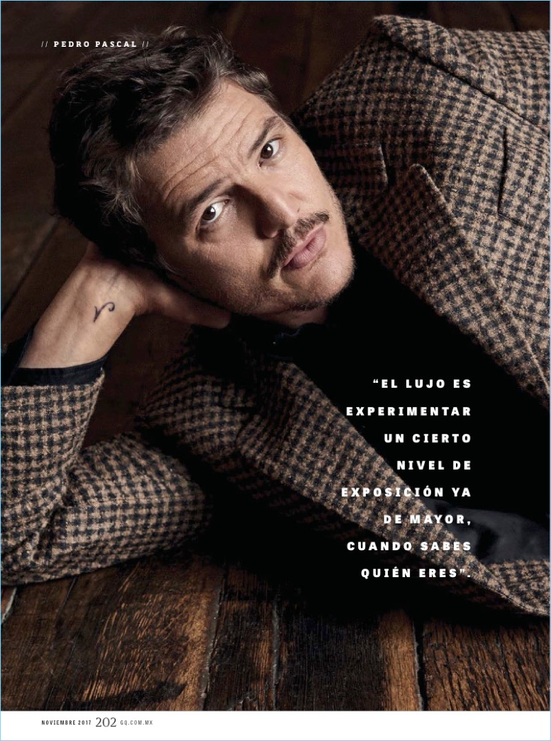 Actor Pedro Pascal wears an E.Tautz coat with a Levi's shirt.